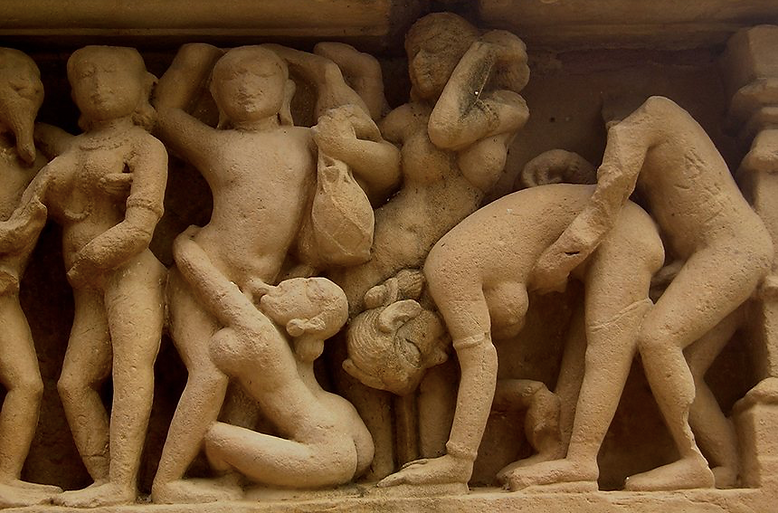 A statue of a group of people enjoying sex.