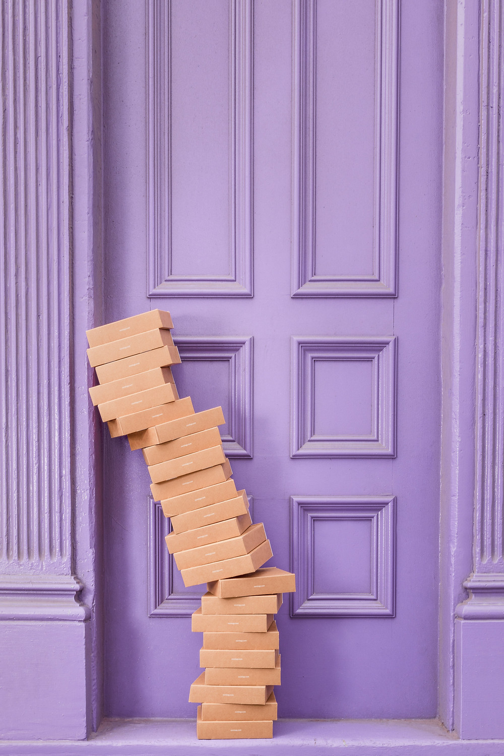 pile of boxes at a door stoop