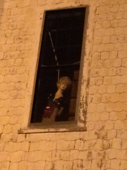 Someone hanging in the window