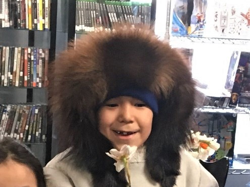 Boy from Barrow with a daffodil