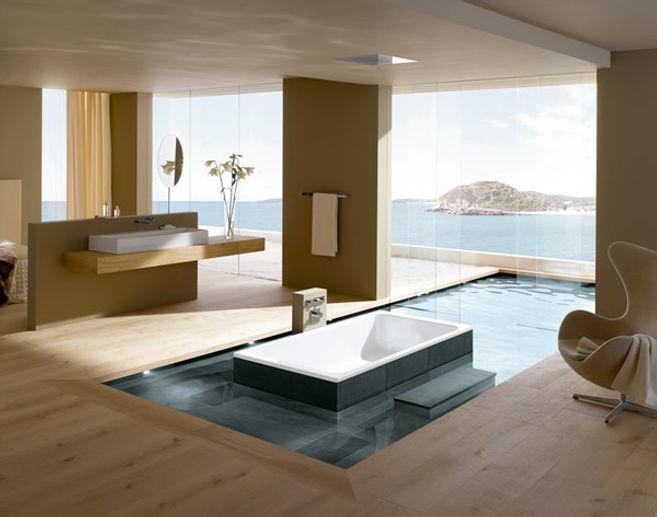 Bathroom setting showing bath tub, faucet, sink, toilet, bathroom fixtures.