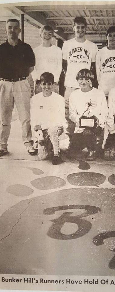 Jeff stands with the Bunker Hill High School state championship cross country team (1990)