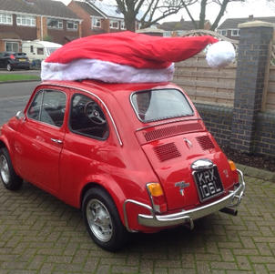 Bella the Fiat 500 gets ready for Christmas with a santa hat.