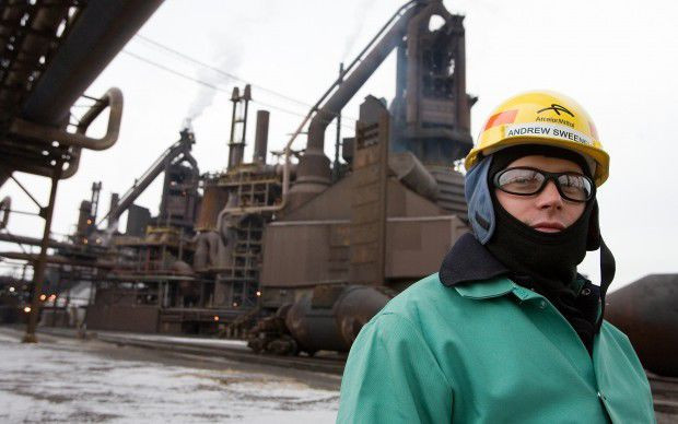 Andrew Sweeney, Matteson, IL, stands in front Arcelor Mittlal blast furnace at Burns Harrbor, IN 2010.