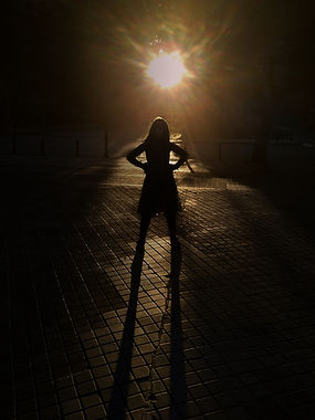 Silhouette of a young girl with her hand