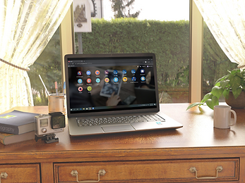 Laptop With KIU Business Management Applications On The Screen