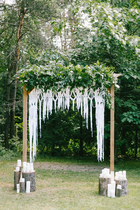Floral wooden arch with macrame and cand