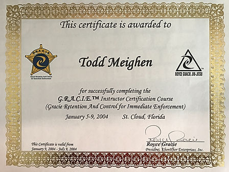 Todd Meighen's Instructor Certificate for completing the G.R.A.C.I.E. Course signed by Royce Gracie