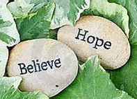 Stones with the words Hope & Believe