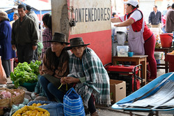 Bolivia, women with hats selling on a food market