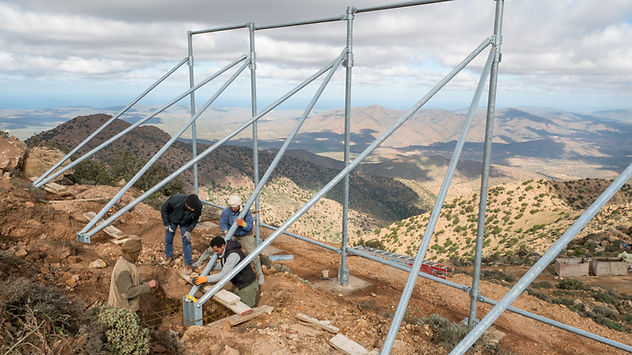 4 Moroccans work on the groundings for the CloudFisher fog collector construction.