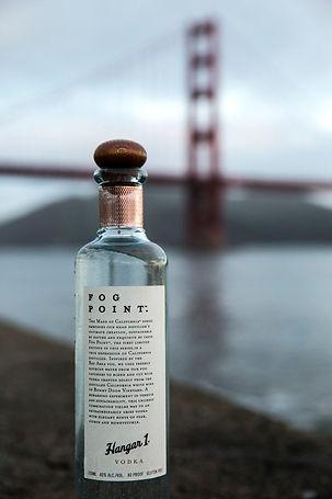 Bottle of Fog Point Hangar 1 Vodka in front of Golden Gate Bridge.