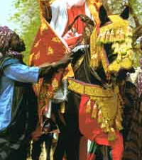 """It is said by the Hausa, """"When people see a horse and rider, they will turn and look at him. They will see him and remember."""""""