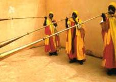 Court musicians play horns announcing Sallah