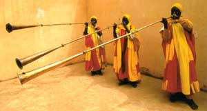 Court musicians play horns announcing Sallah