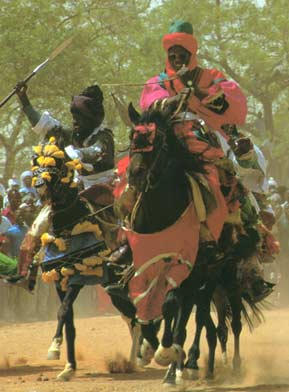 Passing the cheering crowds, horse men race towards the Emir to show their allegiance.