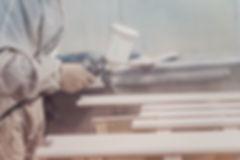 Man painting furniture details. Worker u