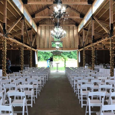 Indoor ceremony inside barn