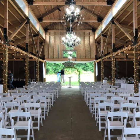 Indoor ceremony inside barn