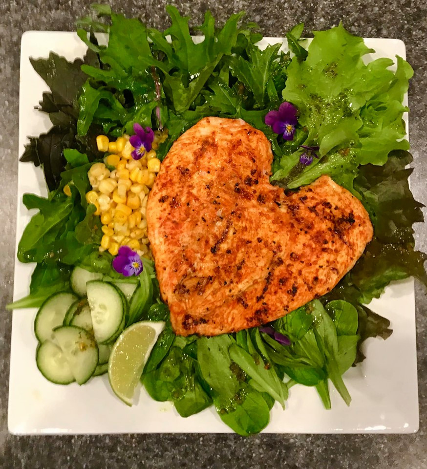 Smoky Mojo chicken on a bed of fresh greens