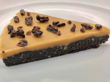 Sticky chewy pecan slice with peanut butter icing & cacao nibs