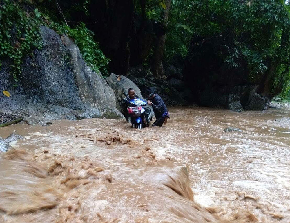 Teachers commuting to school in rainy season