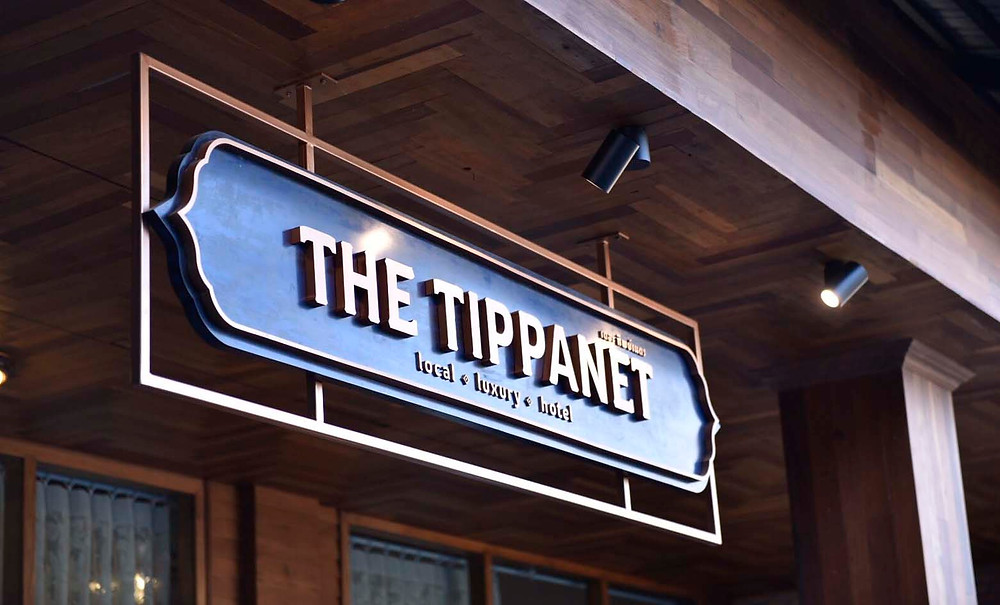 Exterior signage of The Tippanet local luxury hotel