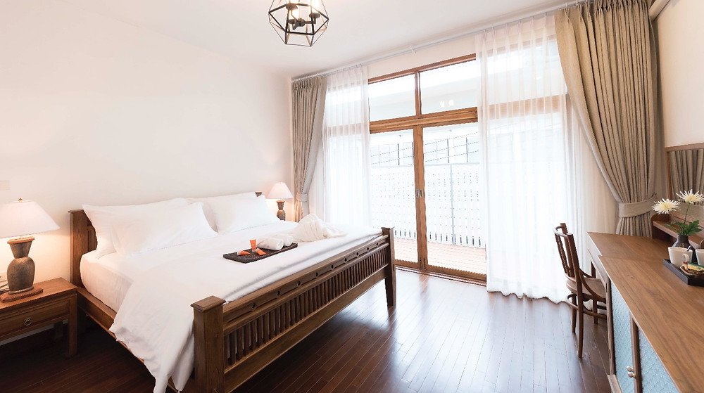 Light and airy Deluxe Room with blackout curtains