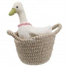 White duck in basket