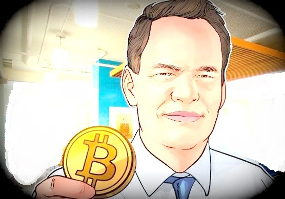 CEO Simon Dixon mit Bitcoin in der Hand