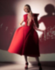 fashion installation art, recycled materials, red foam, plastic table spoons