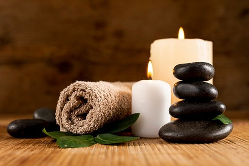 spa-arrangement-with-candles-towel_23-21