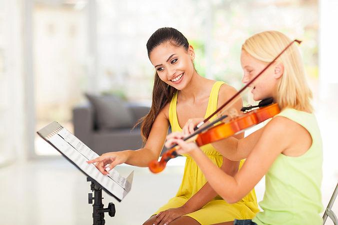 bigstock-preteen-girl-play-violin-under-46068649.jpg