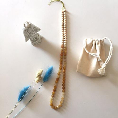 """Le  """"léone"""" en perles de calcite jaune"""