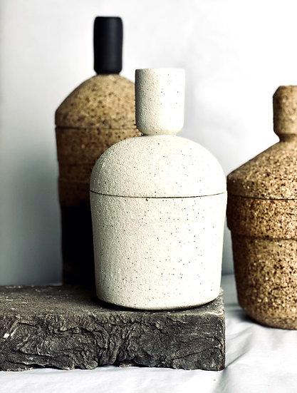 A White Lidded Storage Jar
