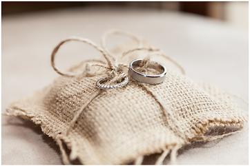 Big Island Photographers capture wedding rings after Hawaii wedding in Kailua Kona.  Big Island wedding photography for gay and lesbian couples