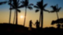 Big Island wedding photographers capture couple in love walking on a Kona beach in Hawaii