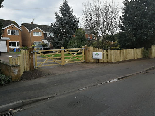 timber wooded double gated frontage on driveway