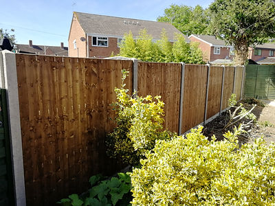 Panelled fence, panel feather edge post closed board