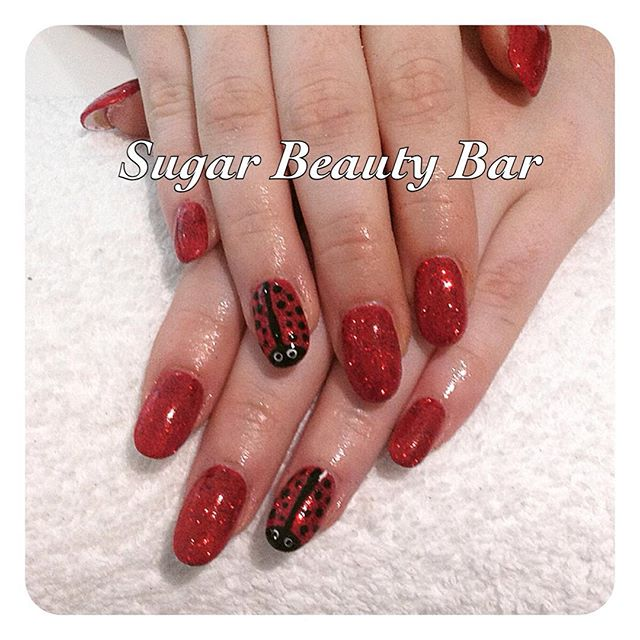 Acrylic infills in red glitter with hand painted ladybirds #acrylicnails #nailart #ladybird