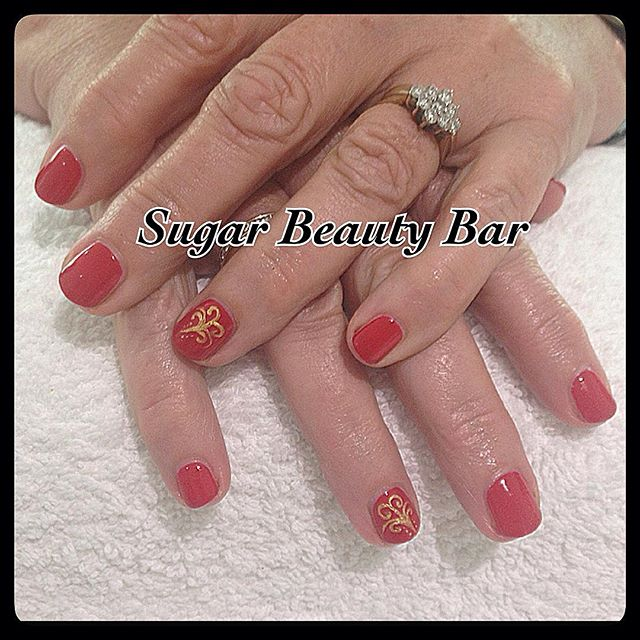 CND Shellac in Wildfire with gold filigree design #shellac #nailart