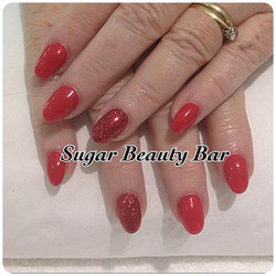 Red almond acrylic extensions with Ruby red glitter ring finger #acrylic #acrylicnails #glitter