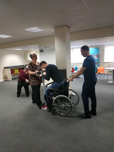 Stand Aid - sitting into wheelchair.jpg