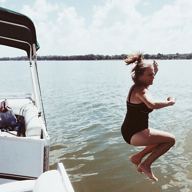 photo lady jumping into water.png