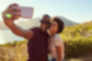 Young Couple Pose For Holiday Selfie On