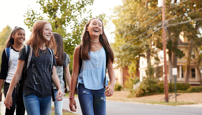 four-young-teen-girls-walking-to-school-