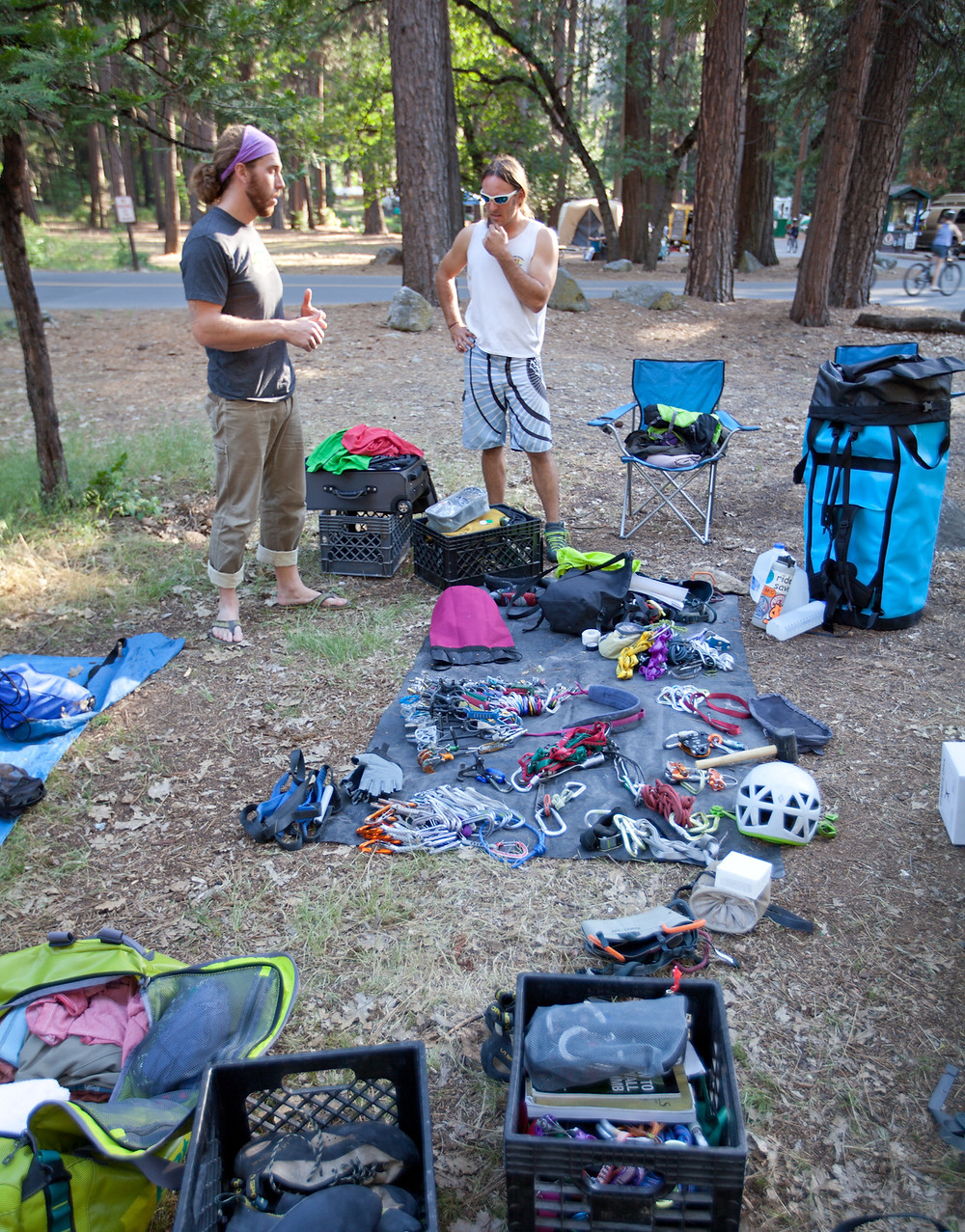 Talking plans and organizing gear at camp.