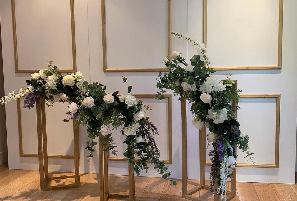 Elegant White & Gold Backdrop with 3 Floral Plinths