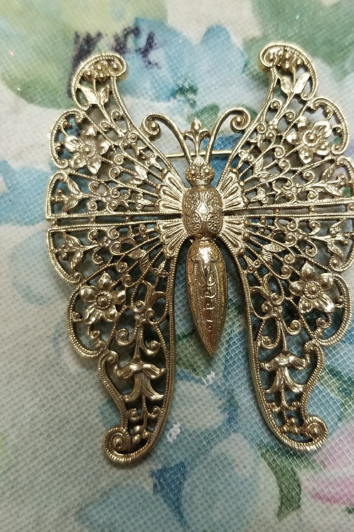 Pin: Gold-toned butterfly brooch delicately detailed