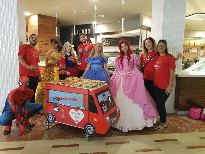 Fantasia, colori, principesse e super eroi al pizza party nei reparti pediatrici